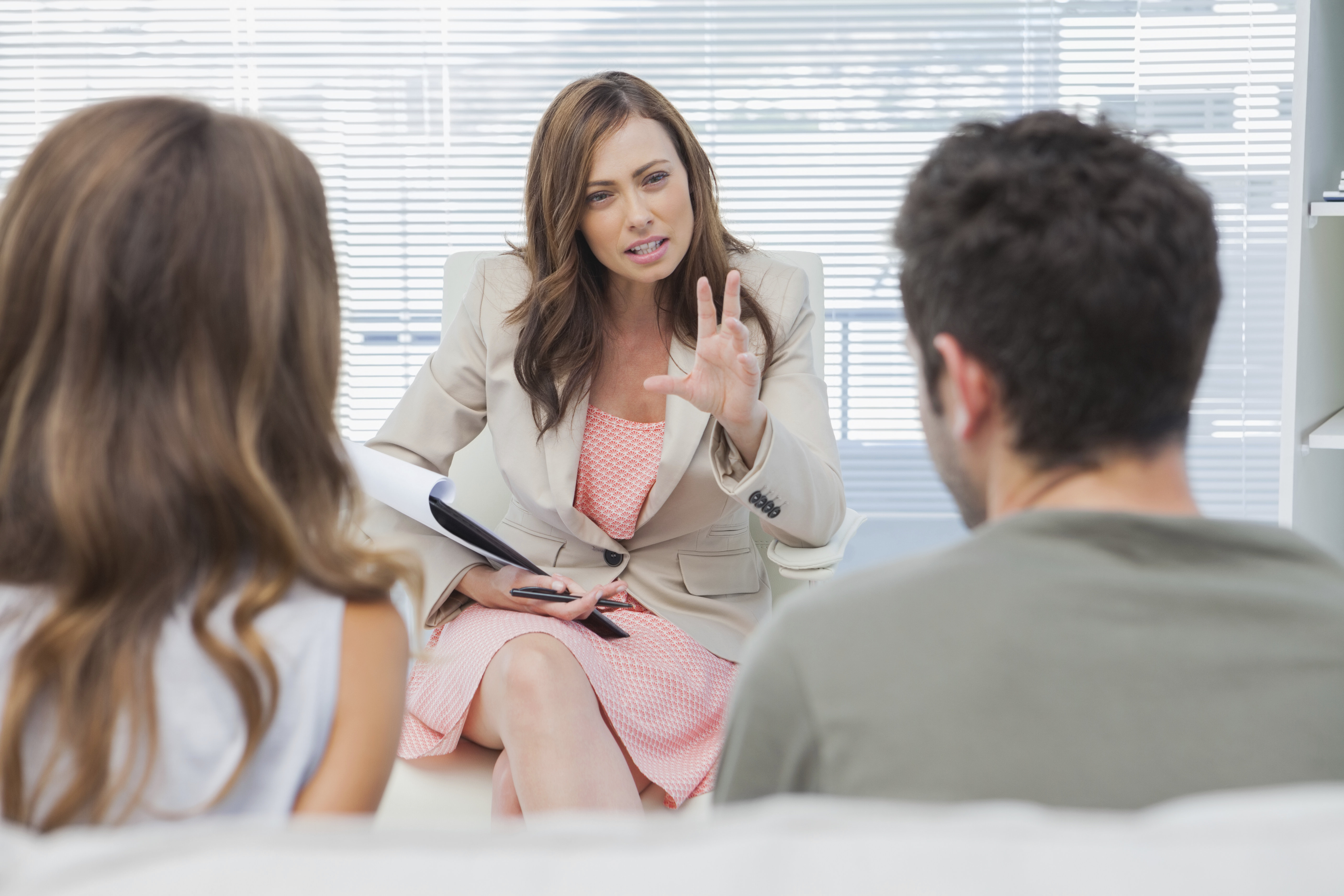 Psychologist discussing with a couple in trouble